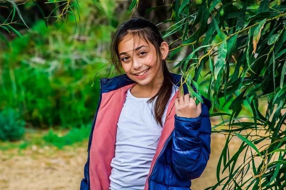 Girl wearing blue jacket