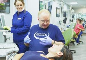 dr. demas helping adult patient during visit