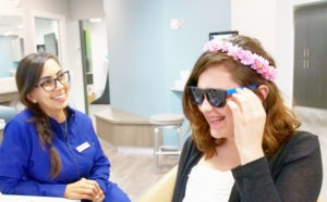 girl trying on sunglasses
