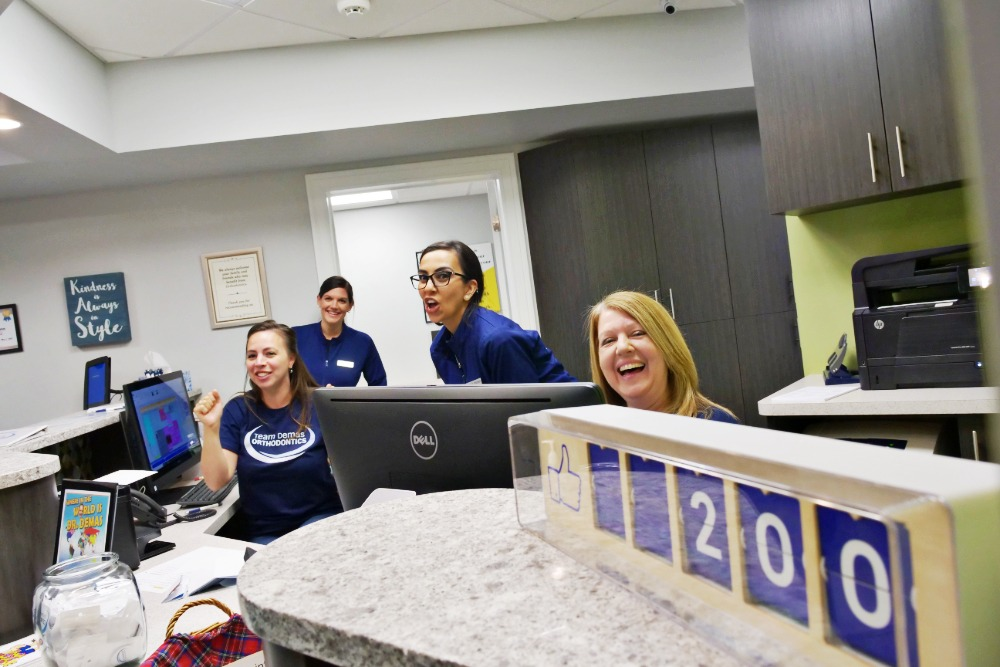 Front desk team laughing