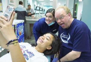 doctor demas taking selfie with young patient
