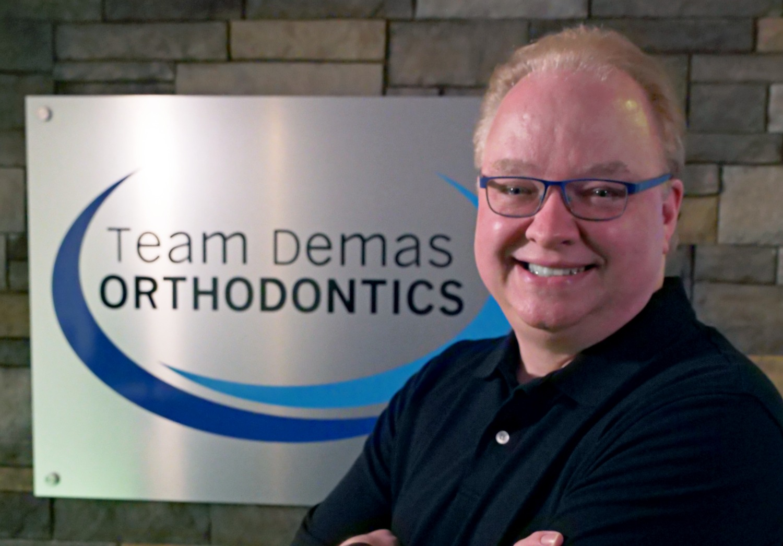 dr. demas headshot southington orthodontist