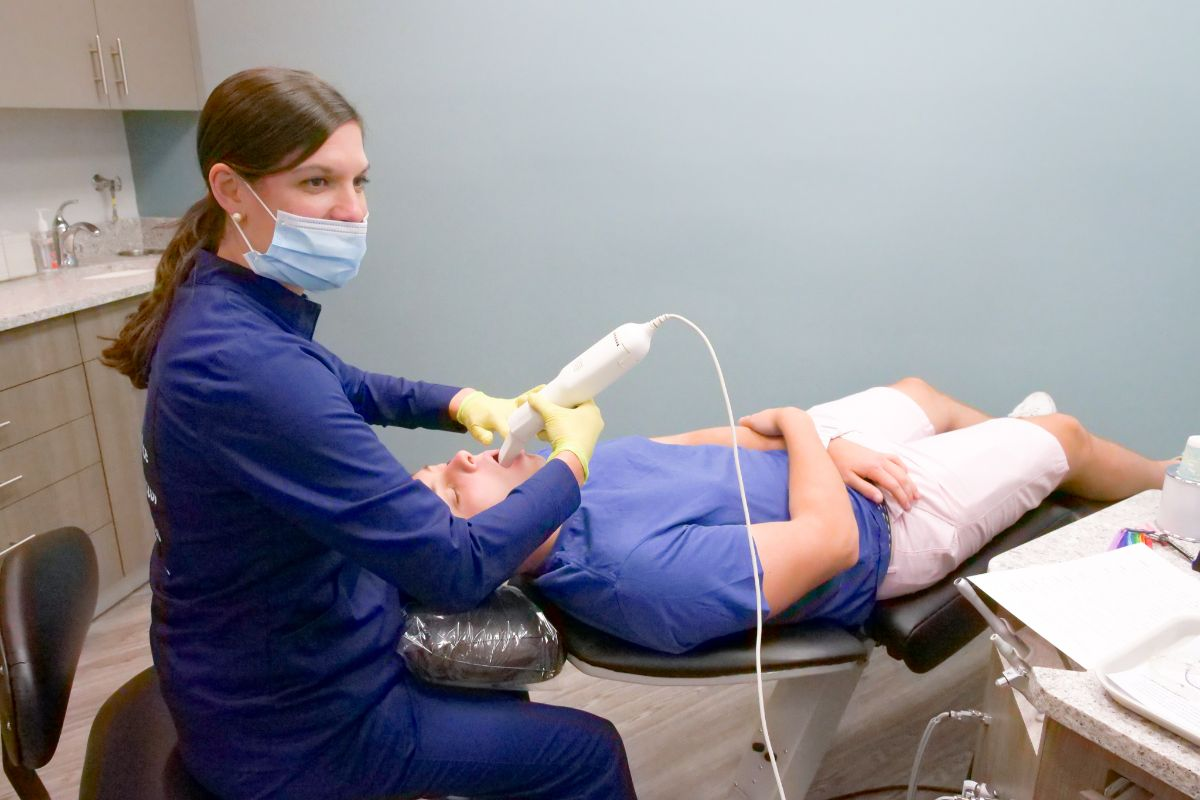Ortho assistant scanning a patient's teeth